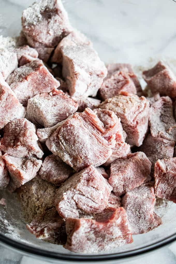 Chuck roast cut into 1 inch pieces and coated in flour, salt and pepper to be seared for beef stew.