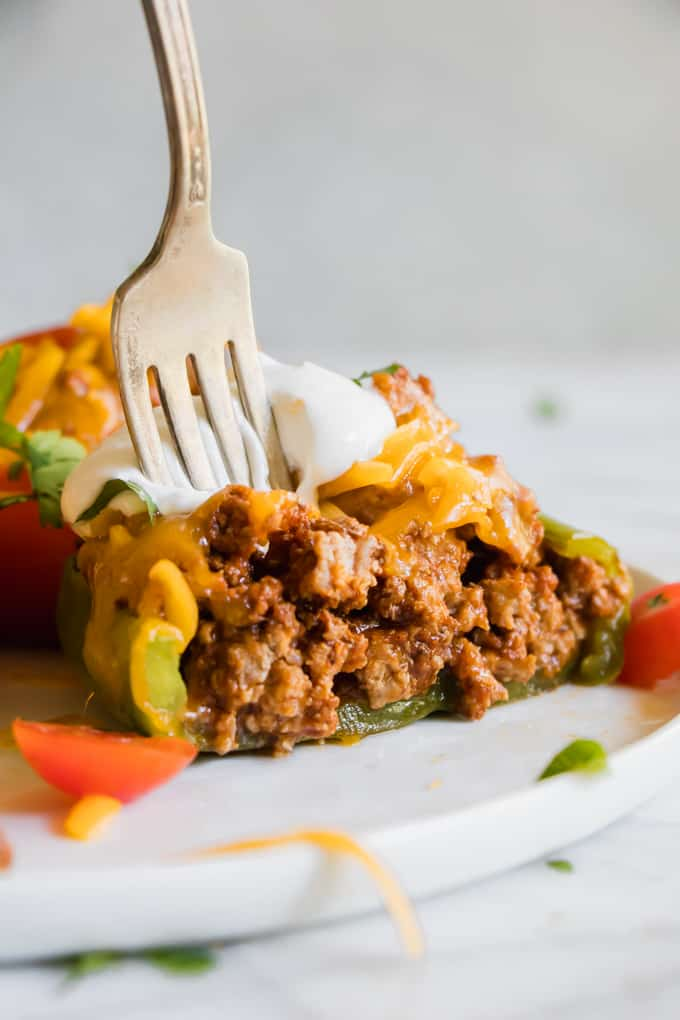 Taco Stuffed Pepper cut into to show all the taco meat filling.