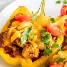 Baked taco stuffed pepper topped with melted cheese.