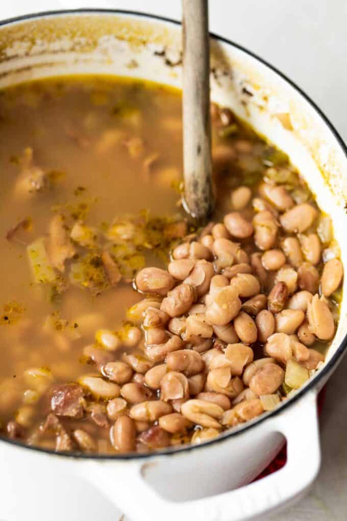 Cooked pinto beans in a dutch oven.
