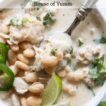 Creamy white chicken chili topped with lime wedges.