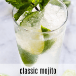 Classic mojito served with a sprig of mint and lime wedges.
