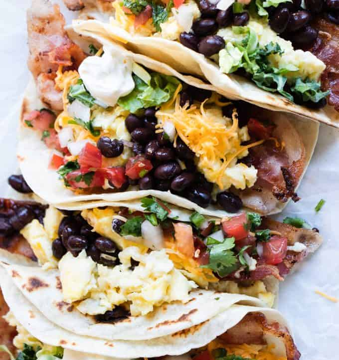 Overhead shot of a tray of southwest breakfast tacos for the family.