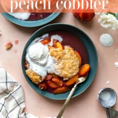 Bowl of dished up peach cobbler served with ice cream.
