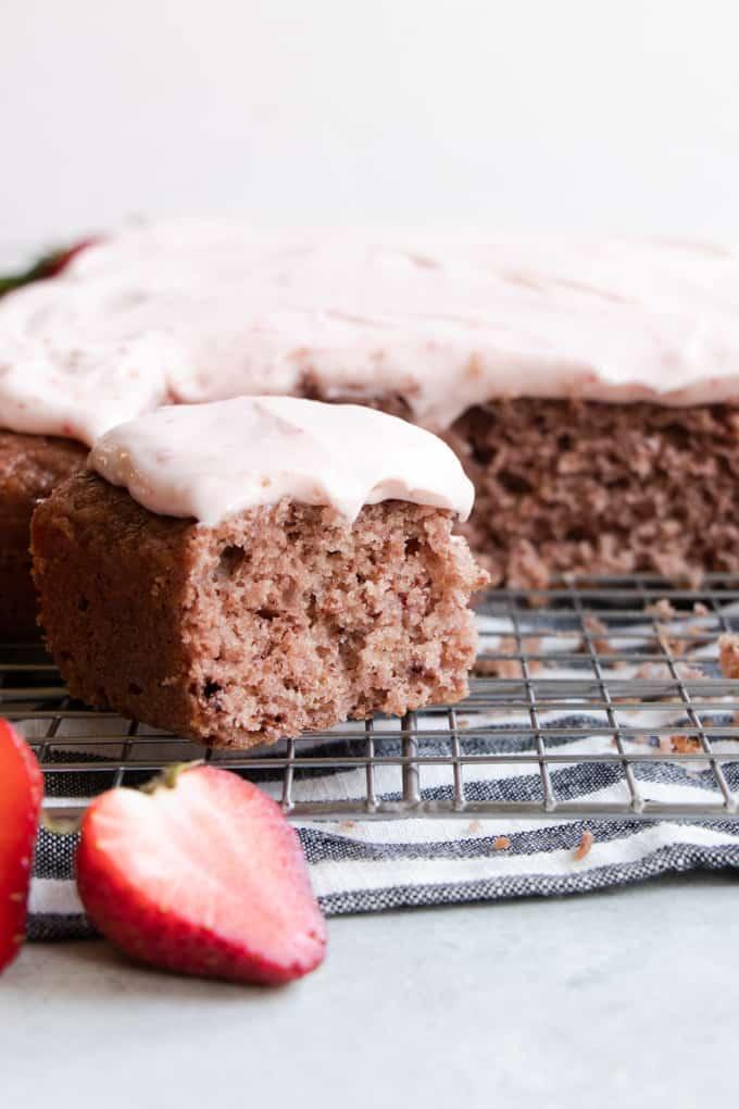 Fresh homemade strawberry cake sliced into pieces.