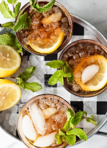 A tray filled with glasses of homemade sweet tea.
