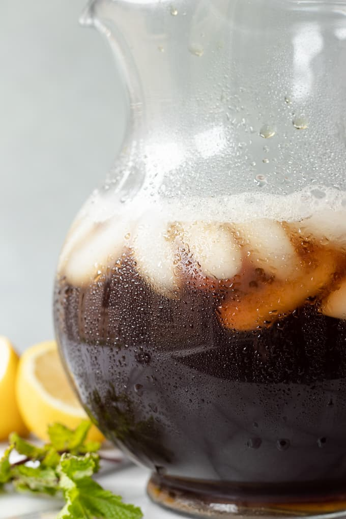 A jug dripping with condensation and filled with homemade sweet tea.