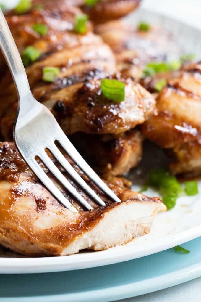 Cut Huli Huli chicken with a fork.