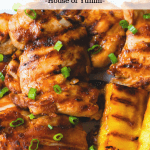 Hawaiian chicken with grilled pineapple on the side.