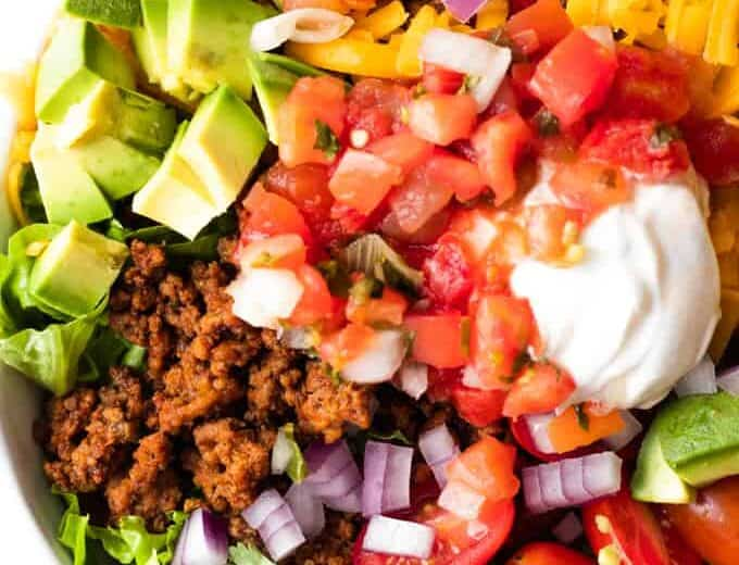 Taco Salad layered and ready to mix.