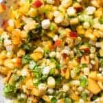 Homemade peach salsa with fresh corn.
