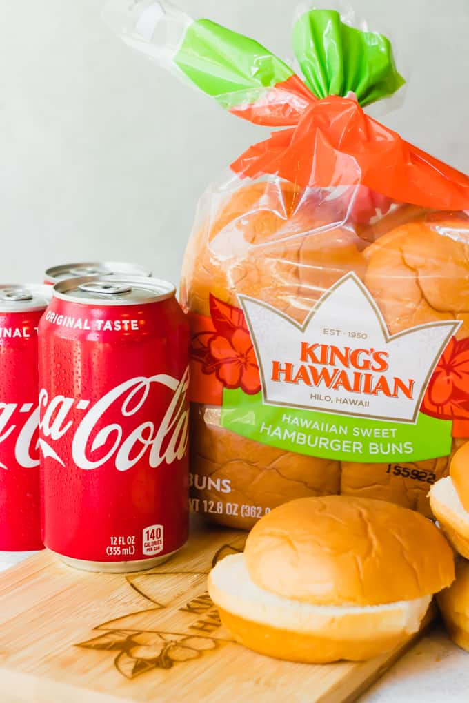 Brand image showing Kings Hawaiian hamburger buns and Coca Cola.