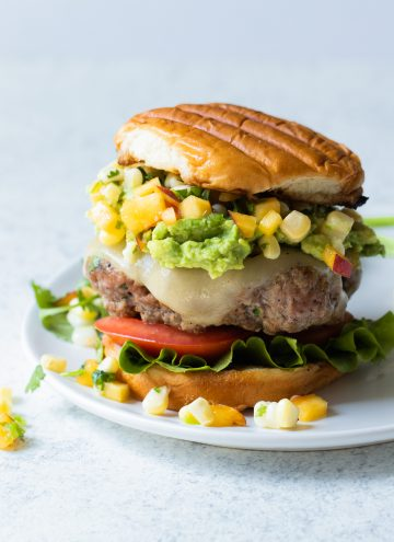 Taco Burger loaded up with guacamole and homemade peach salsa.