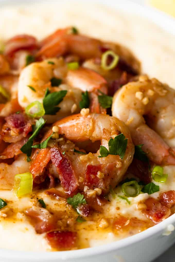 Southern style shrimp and grits served in a bowl topped with fresh parsley.