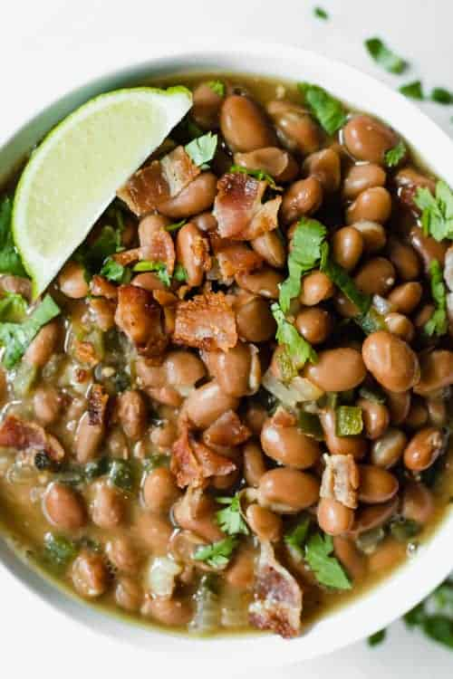 Frijoles Borrachos served in a bowl topped with cilantro.