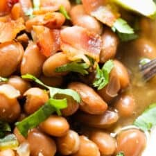 Close up of borracho beans swimming in a beer broth.