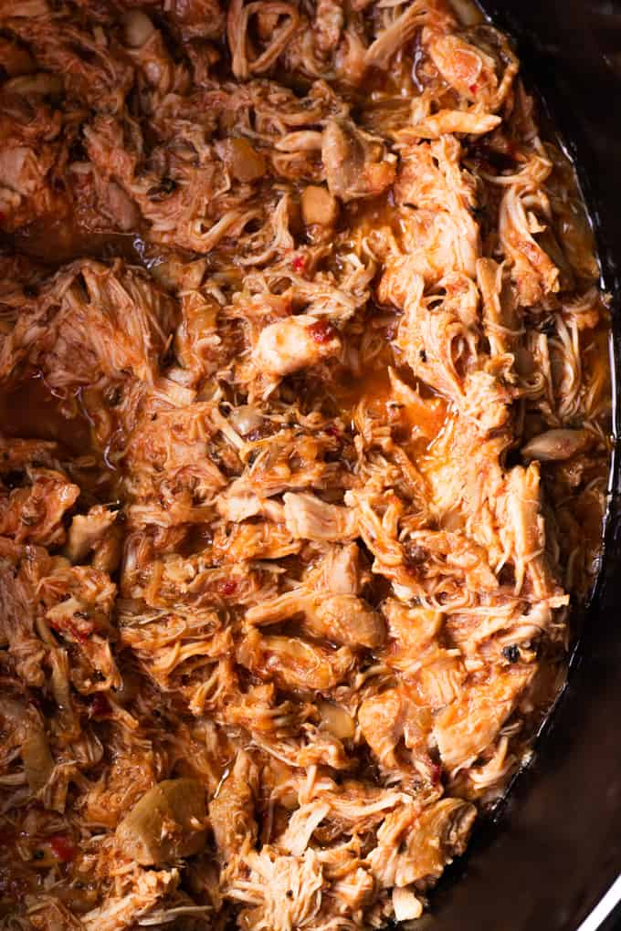 Pot filled with Chicken Tinga, shredded chicken in a chipotle sauce.