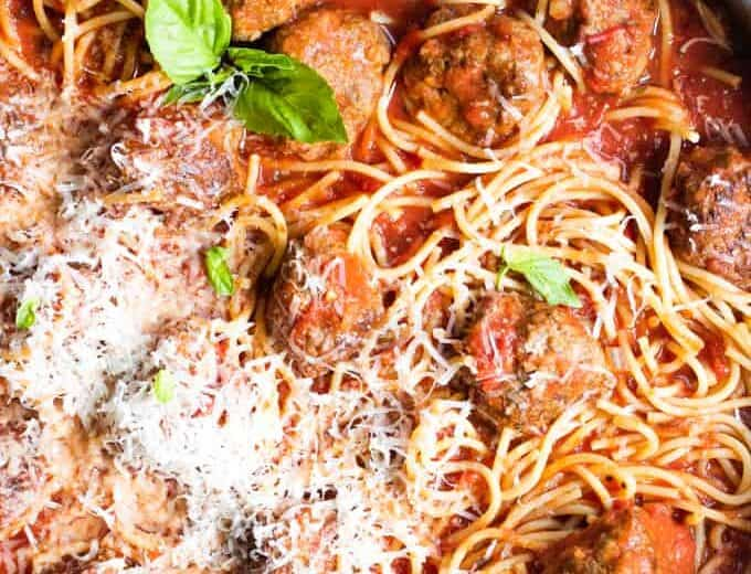 Skillet filled with homemade spaghetti and meatballs.