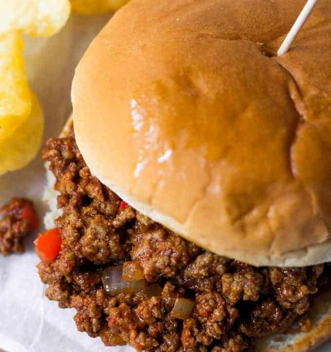 Toasted hamburger bun topped with ground beef coated in a sloppy Joe sauce.