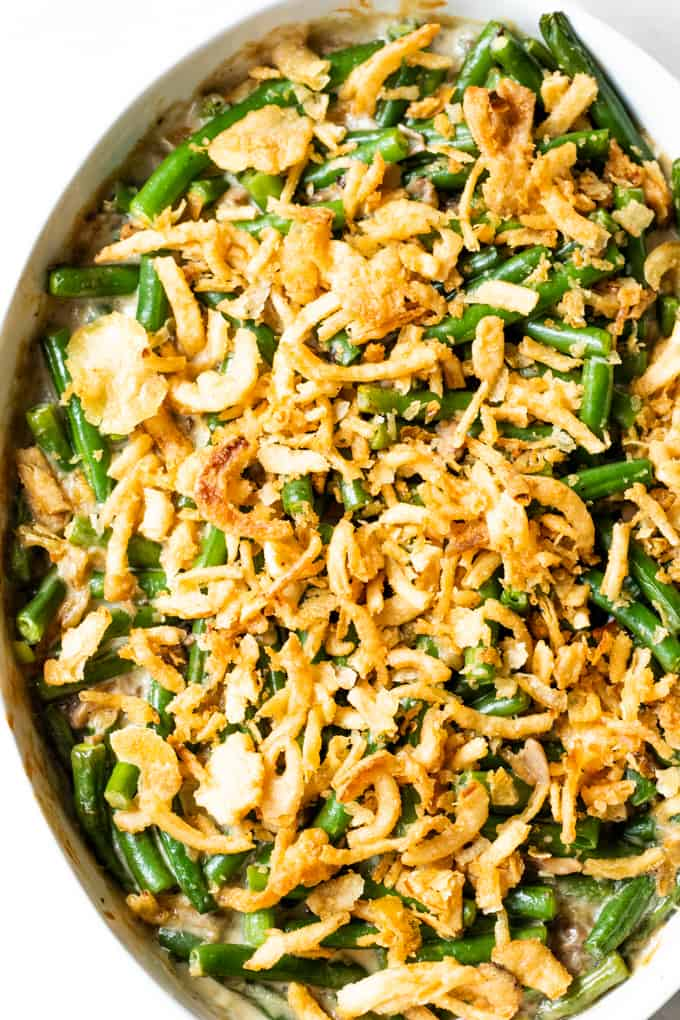Green bean casserole in an oval baking dish.