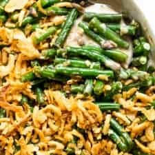 Casserole dish filled with baked green bean casserole.