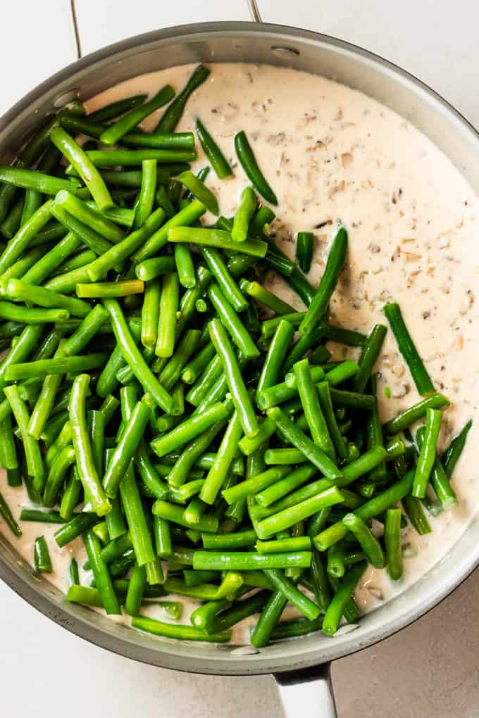 Green beans added on top of a creamy mushroom sauce.