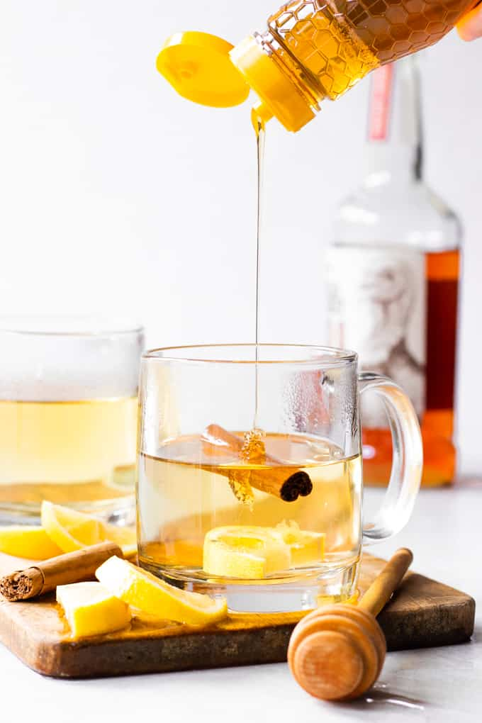 Honey being added to a hot toddy.