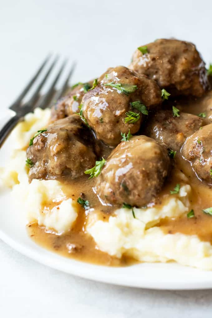 Swedish meatballs served on top of creamy mashed potatoes.