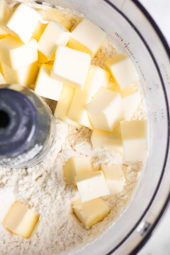 Cold squared butter added to food processor and dry ingredients to make pie crust.