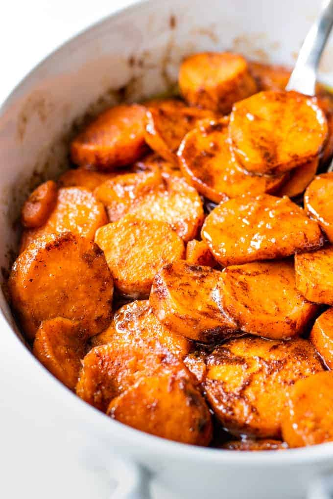 Baking dish filled with candied sweet potatoes.