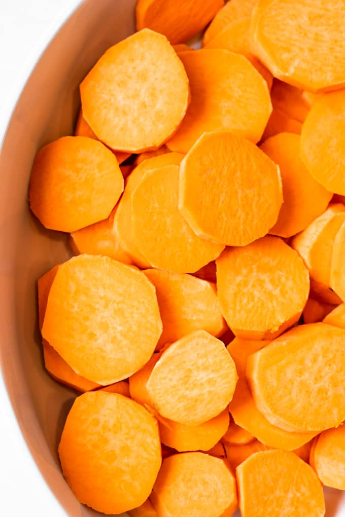 Sliced Sweet Potatoes in a baking dish.