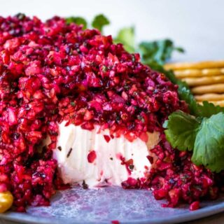 Cranberry salsa served on top of cream cheese with crackers.