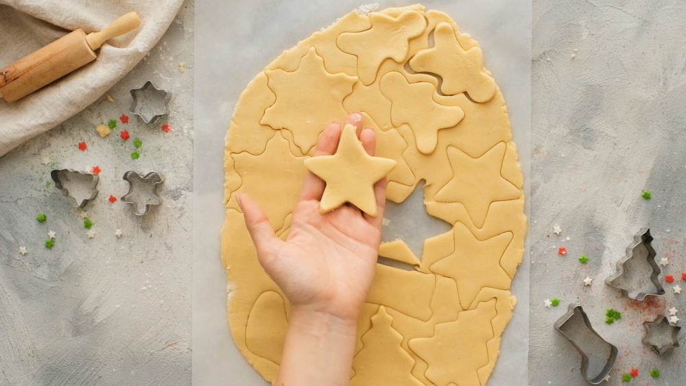 Shapes cut out of sugar cookie dough.