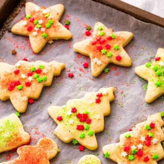 Sugar cookies on a baking sheet.