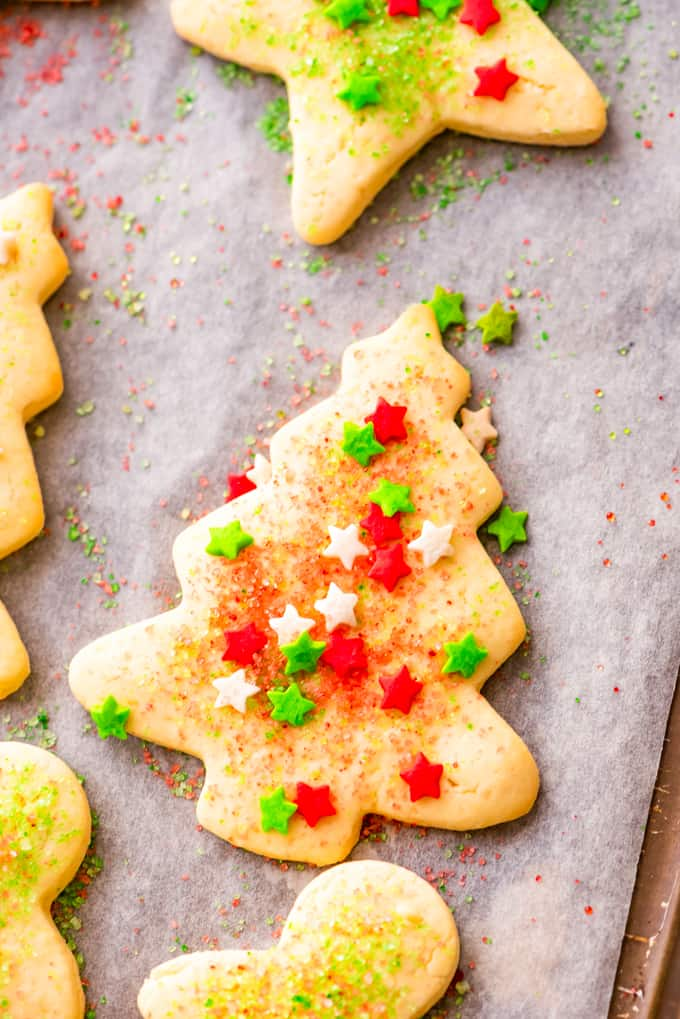 Sugar cookie with Christmas sprinkles on a baking sheet.
