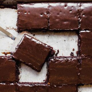 Slices of cut Chocolate sheet cake.