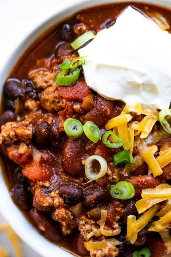 Up close look at turkey chili, showing chunks of ground turkey and beans