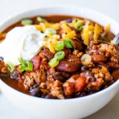 White bowl filled with red turkey chili.