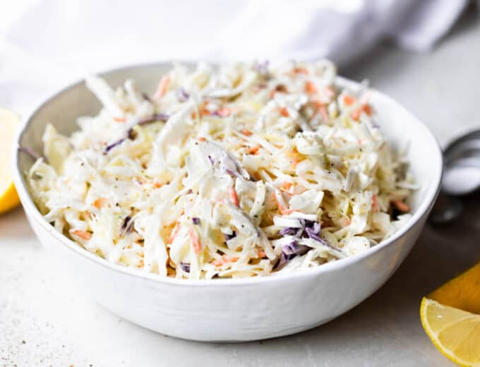 Bowl filled with creamy coleslaw.