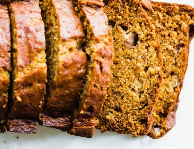 A loaf of banana bread that has been sliced.