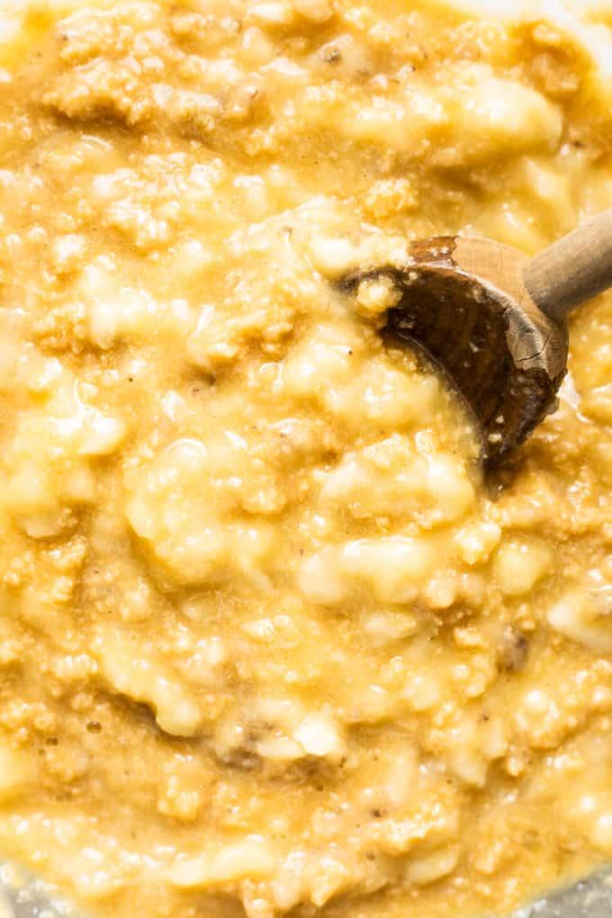 Close up view of mixed banana bread batter.