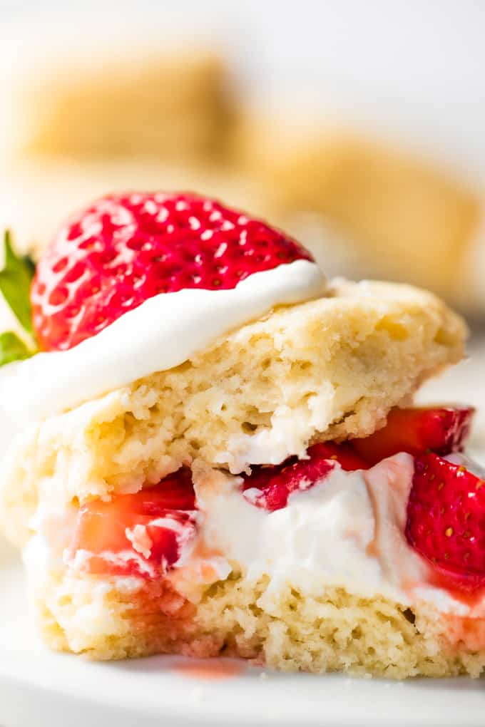Strawberry shortcake made with a buttermilk biscuit, cut in half, layered with whipped cream and diced strawberries.