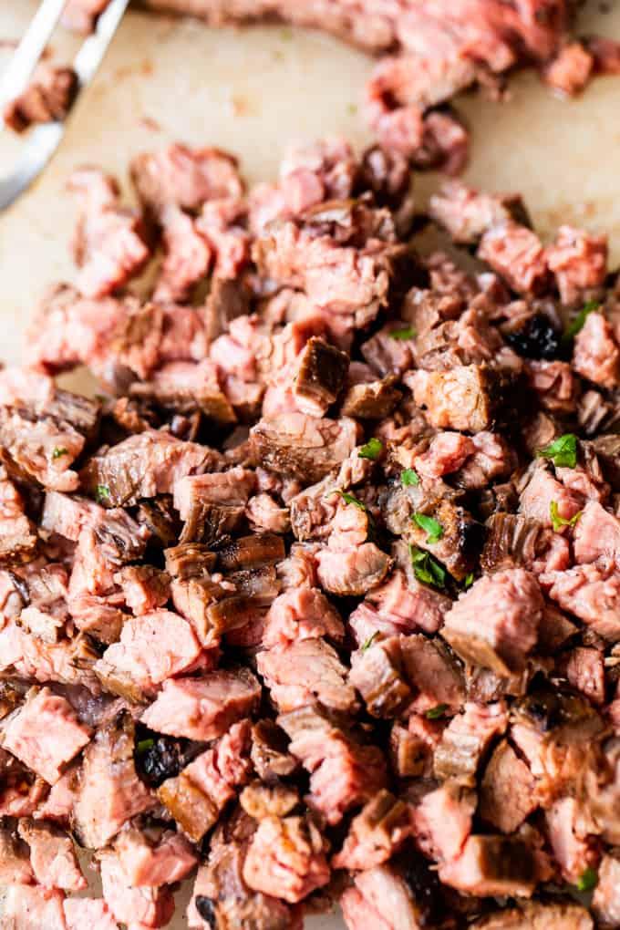 Chopped carne asada that has a slight sprinkling of diced cilantro.