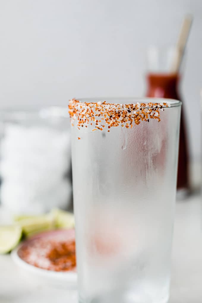 Frosty glass with a rim covered in salt and Tajin.