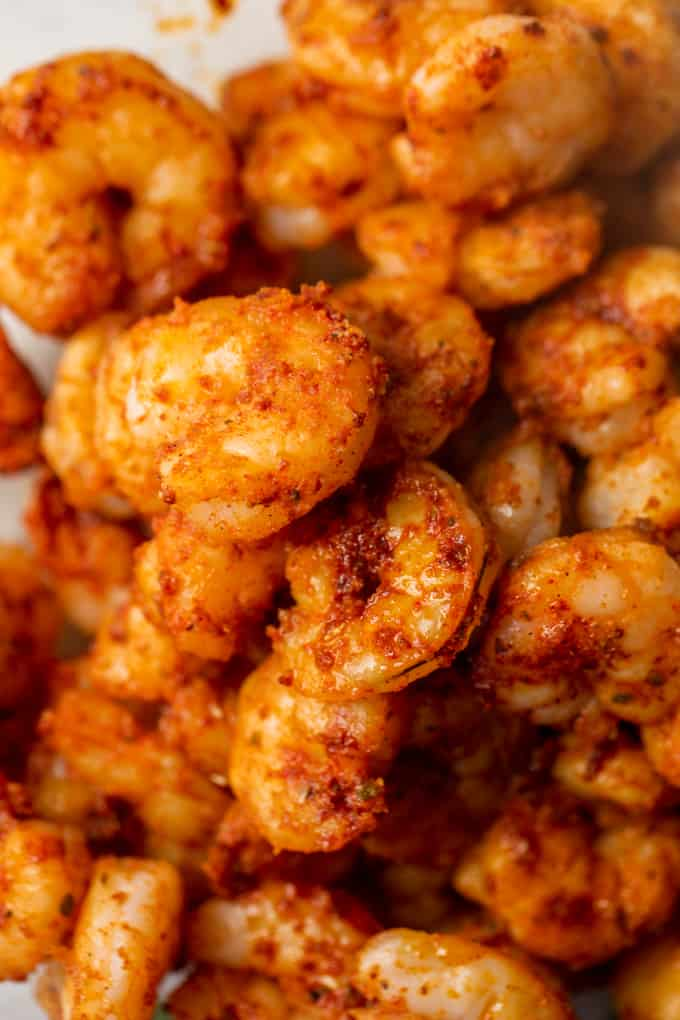 Cooked shrimp that has been coated with homemade taco seasoning.