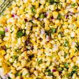 Glass bowl filled with chipotle copy cat corn salsa.