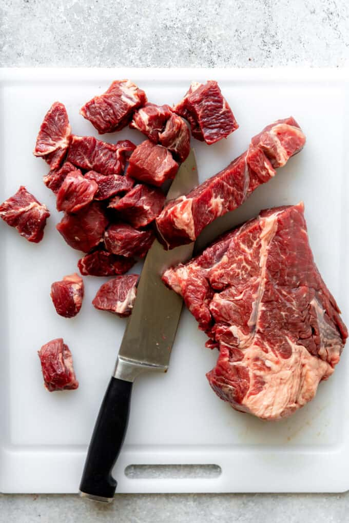 Beef chuck being cut into chunks to make Texas Chili.