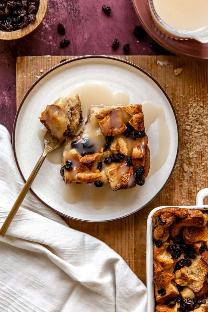 Overhead view of a serving of bread pudding with a fork.