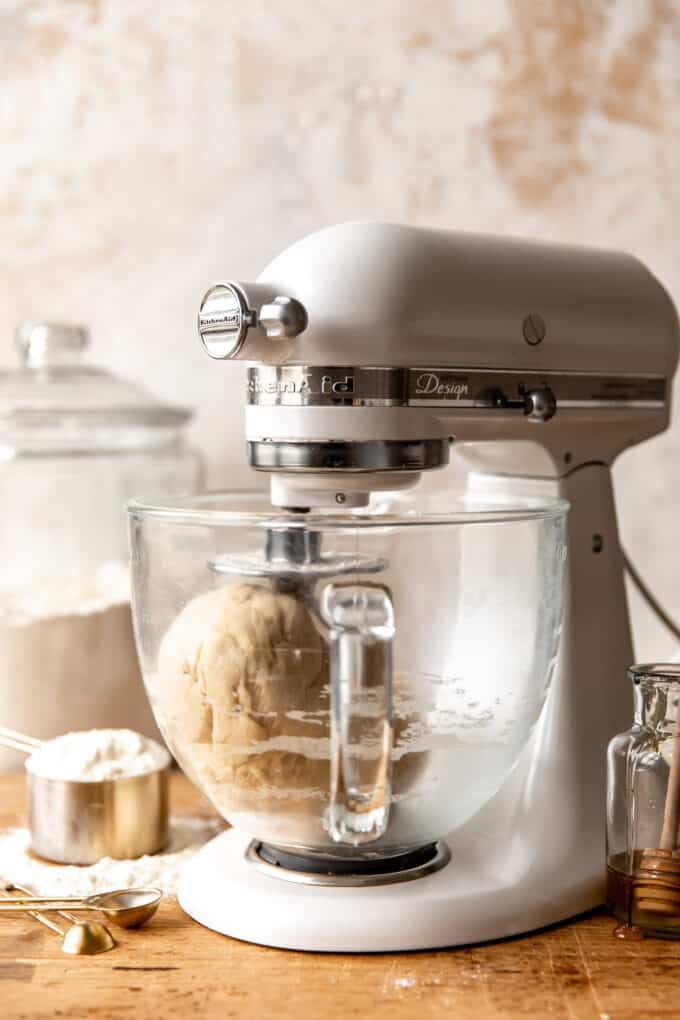 Stand mixer with dough hook kneading dough for Texas Roadhouse Rolls.