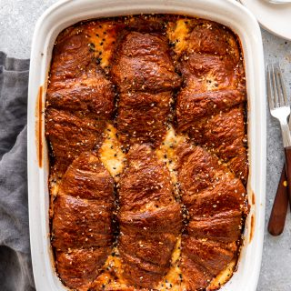 Baking dish with ham and cheese croissant breakfast casserole.